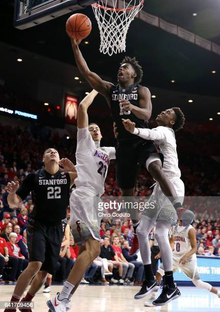 Marcus Allen of the Stanford Cardinal shoots over Chance Comanche of the Arizona Wildcats and Kobi Simmons during the first half of the college...