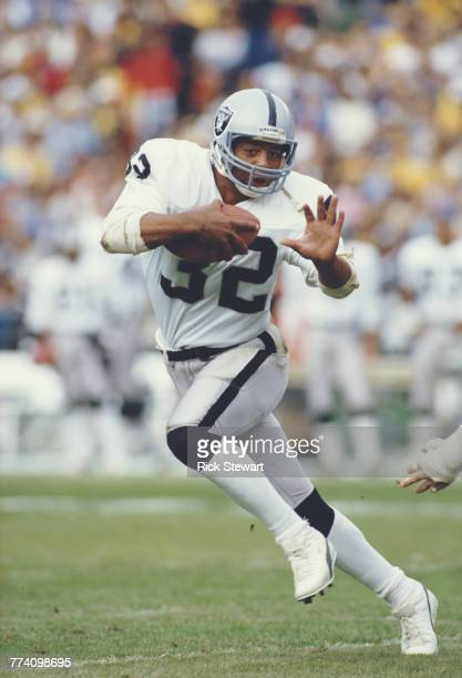 Marcus Allen Running Back for the Los Angeles Raiders runs the ball during the American Football Conference West game against the San Diego Chargers...
