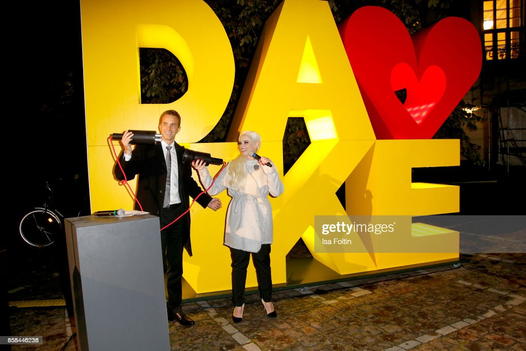 Marcus Almeling and Daniela Katzenberger during the Festival of Lights at Humboldt University on October 6, 2017 in Berlin, Germany. From October 6 till October 15 there will be a light installation on the front of the Humboldt University in Berlin along with other installations around the City. McDonald's Germany celebrates the 30th anniversary of the Ronald McDonald House Charities in Germany.
