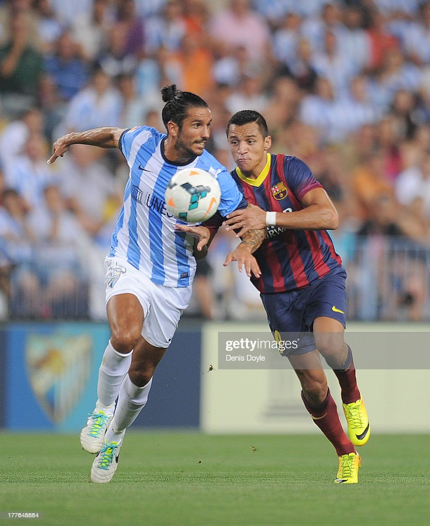 Marcus Angeleri (L) of Malaga CF vies for the ball with Adriano Correia of FC Barcelona during the La Liga match between Malaga CF and FC Barcelona at La Rosaleda Stadium on August 25, 2013 in Malaga, Spain.
