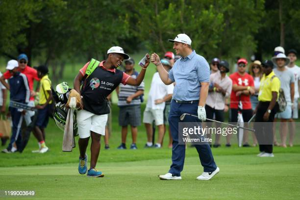 Marcus Armitage of England reacts with his caddy during Day Four of the South African Open at Randpark Golf Club on January 12, 2020 in Johannesburg,...