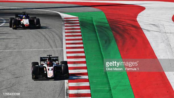 Marcus Armstrong of New Zealand and ART Grand Prix leads Louis Deletraz of Switzerland and Charouz Racing System during qualifying for the Formula 2...