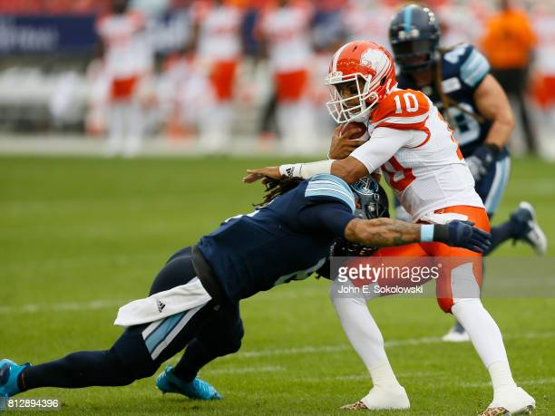Marcus Ball of the Toronto Argonauts makes a tackle on Jonathon Jennings of the BC Lions during a CFL game at BMO Field on June 30 2017 in Toronto...