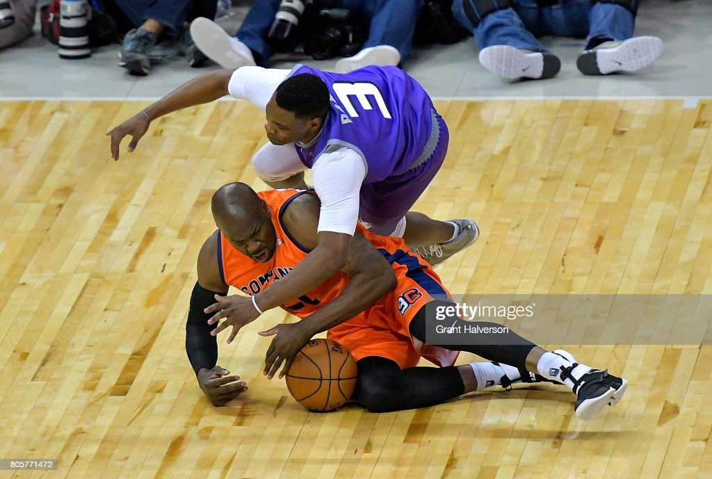 Marcus Banks #3 of Ghost Ballers battles for a loose ball with Ruben Patterson #21 of 3's Compay during week two of the BIG3 three on three basketball league at Spectrum Center on July 2, 2017 in Charlotte, North Carolina.
