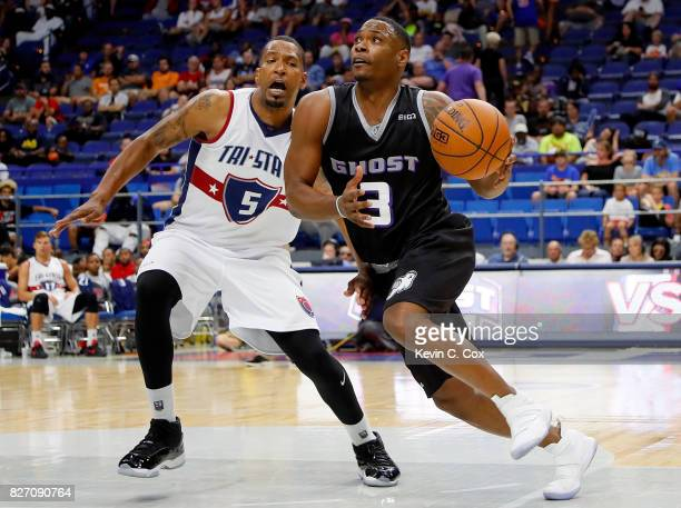 Marcus Banks of Ghost Ballers drives past Dominic McGuire of TriState during week seven of the BIG3 three on three basketball league at Rupp Arena on...