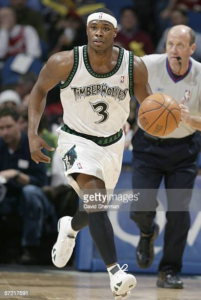 Marcus Banks of the Minnesota Timberwolves dribbles against the Houston Rockets on March 7 2006 at the Target Center in Minneapolis Minnesota The...
