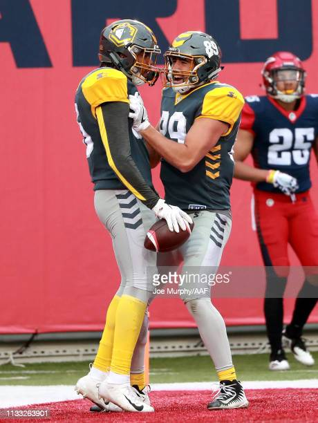 Marcus Baugh of San Diego Fleet is congratulated by his teammate Gavin Escobar of San Diego Fleet after a touchdown against the Memphis Express...