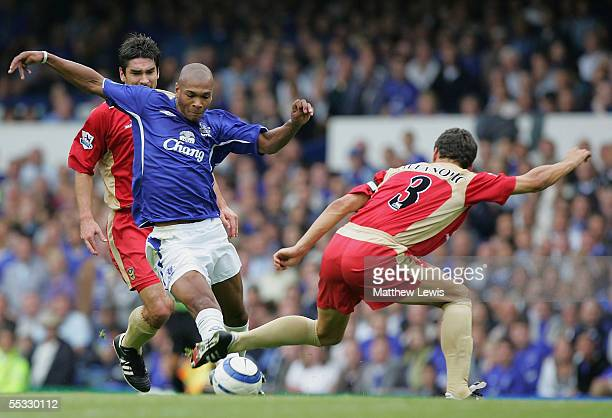 Marcus Bent of Everton is tackled by Dejan Stefanovic of Portsmouth during the Barclays Premiership match between Everton and Portsmouth at Goodison...