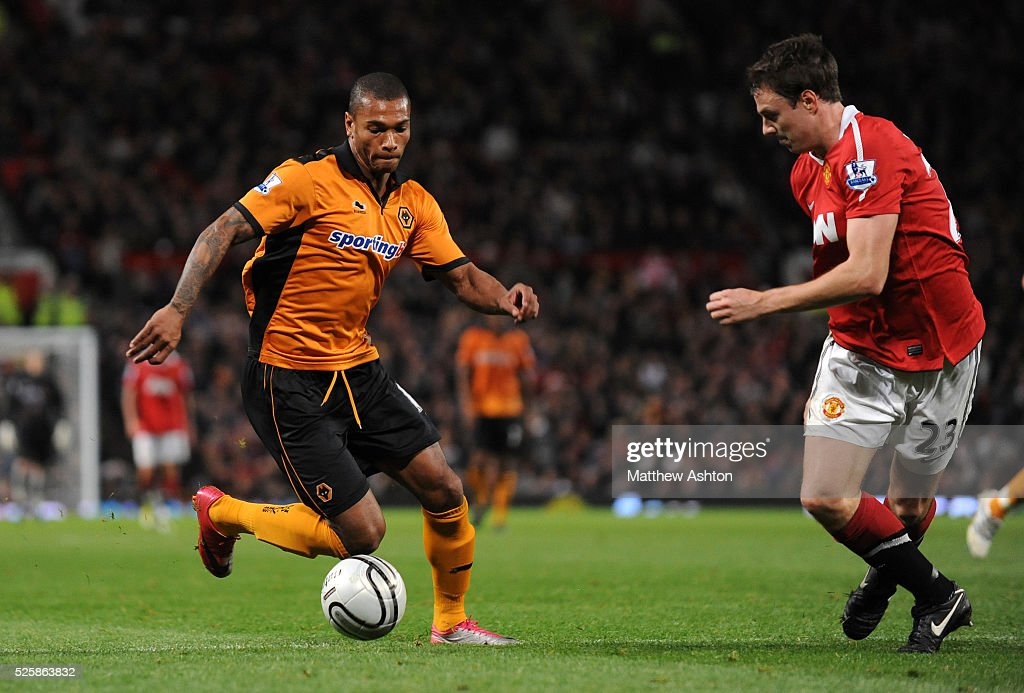 https://media.gettyimages.com/photos/marcus-bent-of-wolverhampton-wanderers-and-jonny-evans-of-manchester-picture-id525863832
