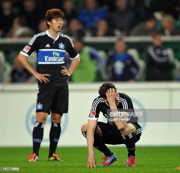 Marcus Berg and Heung Min Son of Hamburg look dejected during the Bundesliga match between VfL Wolfsburg and Hamburger SV at Volkswagen Arena on...