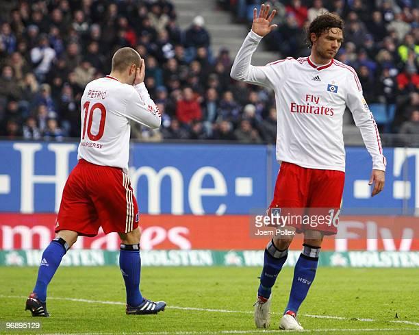 Marcus Berg and Mladen Petric of Hamburg gesture during the Bundesliga match between Hamburger SV and Eintracht Frankfurt at HSH Nordbank Arena on...