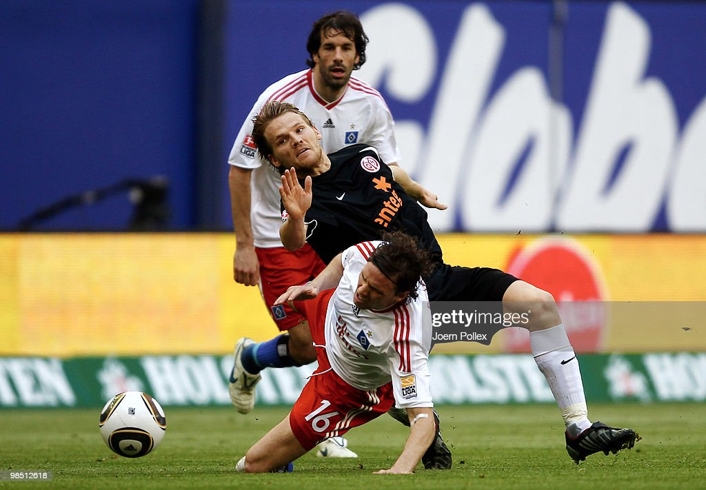 Marcus Berg and Ruud van Nistelrooy of Hamburg as well as Eugen Polanski of Mainz compete for the ball during the Bundesliga match between Hamburger SV and FSV Mainz 05 at HSH Nordbank Arena on April 17, 2010, in Hamburg, Germany.