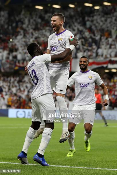 Marcus Berg of Al Ain celebrates after scoring his team's first goal with Ahmed Barman of Al Ain during the FIFA Club World Cup UAE 2018 Semi Final...