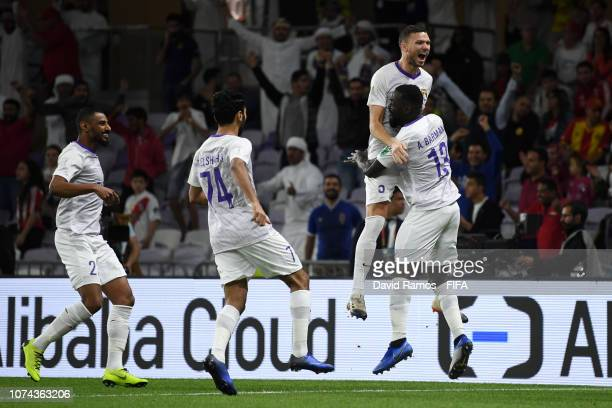 Marcus Berg of Al Ain celebrates with teammates after scoring his team's first goal during the FIFA Club World Cup UAE 2018 Semi Final Match between...