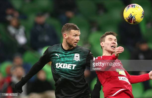 Marcus Berg of FC Krasnodar vies for the ball with Anton Kilin of FC Tambov during the Russian Premier League match between FC Krasnodar v FC Tambov...