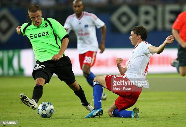 Marcus Berg of Hamburg and Jonas Damborg of Randers compete for the ball during the UEFA Europa League second leg match between Hamburger SV and...