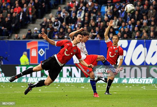 Marcus Berg of Hamburg and Karim Haggui of Hannover compete for the ball during the Bundesliga match between Hamburger SV and Hannover 96 at HSH...
