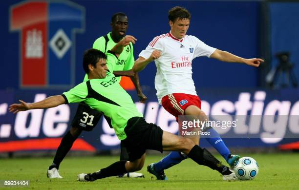 Marcus Berg of Hamburg and Robert Arzumanyan of Randers compete for the ball during the UEFA Europa League second leg match between Hamburger SV and...