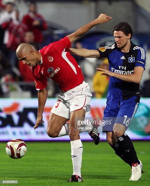 Marcus Berg of HSV and Douglas da Silva of Tel Aviv battle for the ball during their Group C UEFA Europa League match on December 17 2009 in Tel Aviv...