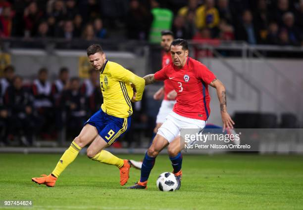 Marcus Berg of Sweden and Enzo Roco of Chile competes for the ball during the International Friendly match between Sweden and Chile at Friends arena...