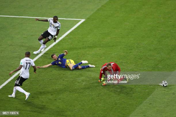 Marcus Berg of Sweden appeals for a penalty after a challenge from Jerome Boateng of Germany and Manuel Neuer as Antonio Ruediger looks on during the...