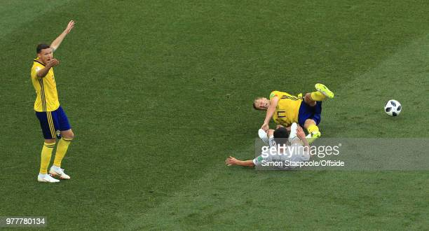 Marcus Berg of Sweden calls out to the referee after Kim MinWoo of South Korea fouls Viktor Claesson of Sweden and gives away a penalty during the...