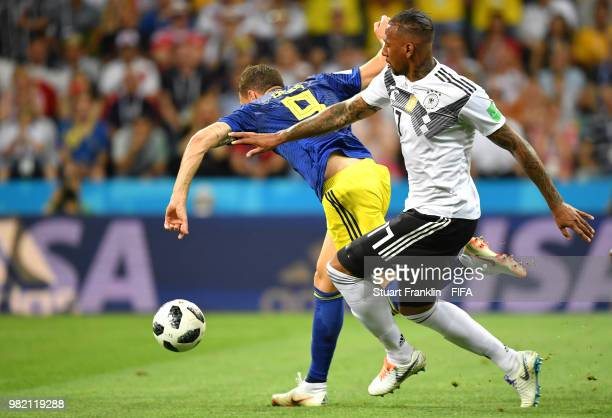 Marcus Berg of Sweden goes down in the penalty area from challenge by Jerome Boateng of Germany during the 2018 FIFA World Cup Russia group F match...