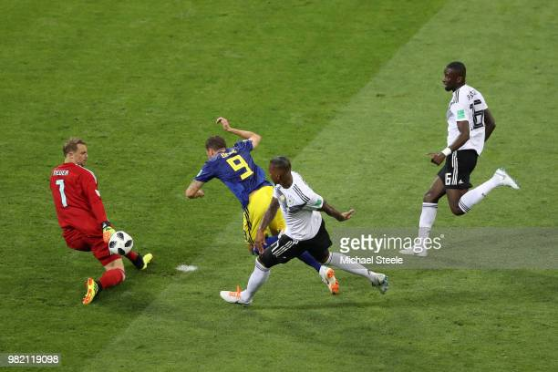 Marcus Berg of Sweden goes down in the penalty area from challenge from Jerome Boateng of Germany as Manuel Neuer makes a save during the 2018 FIFA...
