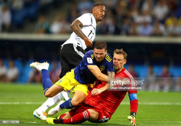 Marcus Berg of Sweden goes down in the penalty area under challenge from Jerome Boateng and Manuel Neuer during the 2018 FIFA World Cup Russia group...