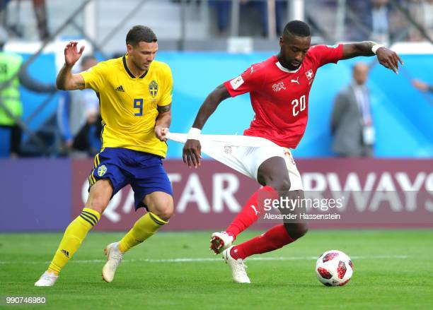Marcus Berg of Sweden holds back Johan Djourou of Switzerland during the 2018 FIFA World Cup Russia Round of 16 match between Sweden and Switzerland...