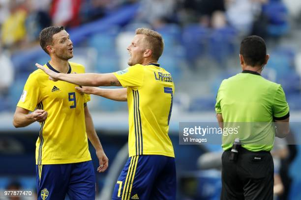 Marcus Berg of Sweden Sebastian Larsson of Sweden referee Joel Aguilar during the 2018 FIFA World Cup Russia group F match between Sweden and Korea...