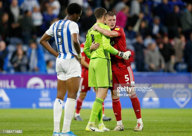 Marcus Bettinelli of Fulham and Alfie Mawson of Fulham embrace after winning the Sky Bet Championship match between Huddersfield Town and Fulham at...