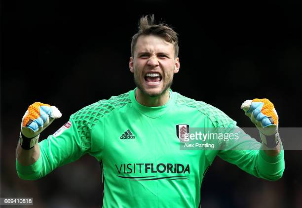 Marcus Bettinelli of Fulham celebrates after his side score their first goal during the Sky Bet Championship match between Fulham and Aston Villa at...