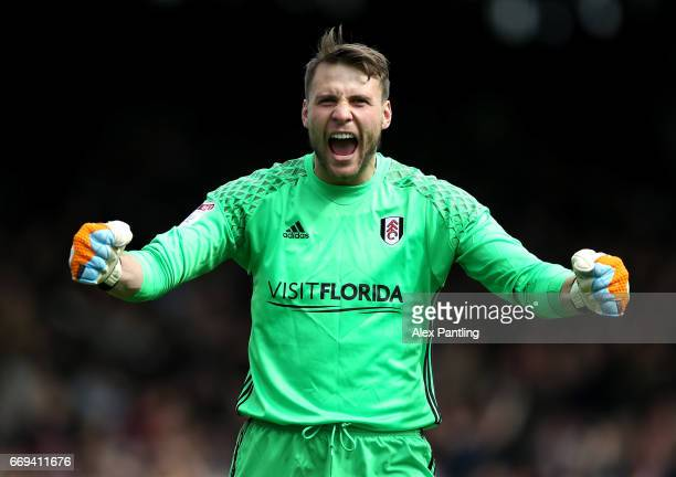 Marcus Bettinelli of Fulham celebrates as his side score their first goal during the Sky Bet Championship match between Fulham and Aston Villa at...