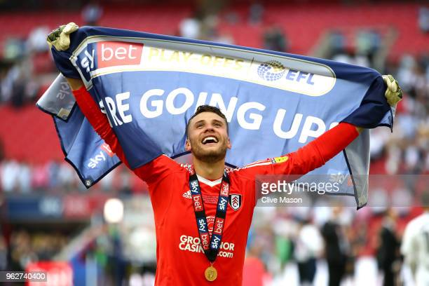 Marcus Bettinelli of Fulham celebrates following his sides victory in the Sky Bet Championship Play Off Final between Aston Villa and Fulham at...