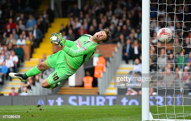 Marcus Bettinelli of Fulham FC is unable to save Middlesbrough's 3rd goal scored by Kike during the Sky Bet Championship match between Fulham and...