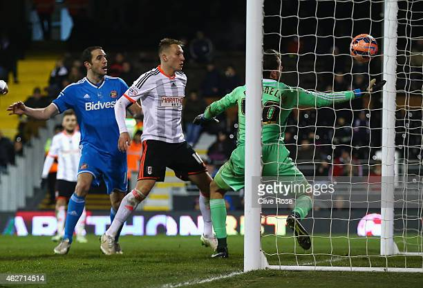 Marcus Bettinelli of Fulham fumbles the ball in to his own net for Sunderland's opening goal during the FA Cup Fourth Round Replay match between...