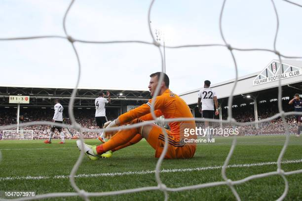 Marcus Bettinelli of Fulham looks dejected after PierreEmerick Aubameyang of Arsenal's first goal during the Premier League match between Fulham FC...