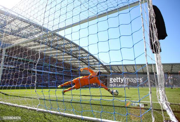 Marcus Bettinelli of Fulham saves a penalty from Pascal Gross of Brighton and Hove Albion during the Premier League match between Brighton Hove...