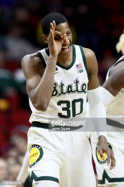 Marcus Bingham Jr #30 of the Michigan State Spartans celebrates a three point basket against the Minnesota Golden Gophers during the second half in...