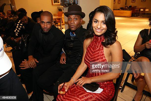 Marcus Blassingame Dapper Afrika and Kelsey Adams attend the Denim And Diamonds Fashion Showcase at Manhattan Motorcars on October 27 in New York City