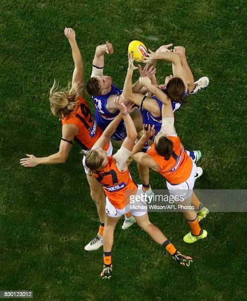 Marcus Bontempelli and teammate Jordan Roughead of the Bulldogs compete for the ball against Nick Haynes Harrison Himmelberg and Phil Davis of the...