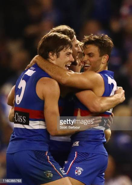 Marcus Bontempelli, Josh Dunkley of the Bulldogs and Sam Lloyd of the Bulldogs celebrate at the final siren after winning the round 16 AFL match...