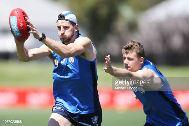 Marcus Bontempelli marks the ball ahead of Jackson Macrae during a Western Bulldogs AFL training session at Whitten Oval on December 04 2018 in...