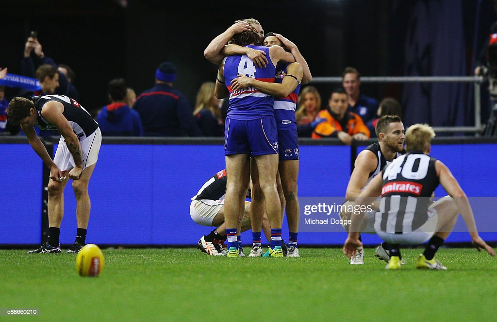 Marcus Bontempelli of the Bulldogs and teammates celebrates the win on the final siren during the round 21 AFL match between the Western Bulldogs and the Collingwood Magpies at Etihad Stadium on August 12, 2016 in Melbourne, Australia.