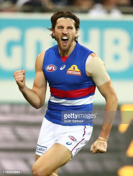 Marcus Bontempelli of the Bulldogs celebrates after kicking a goal during the round nine AFL match between the Geelong Cats and the Western Bulldogs...