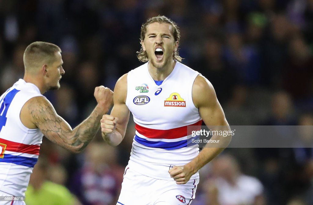Marcus Bontempelli of the Bulldogs celebrates after kicking a goal during the round four AFL match between the North Melbourne Kangaroos and the Western Bulldogs at Etihad Stadium on April 14, 2017 in Melbourne, Australia.