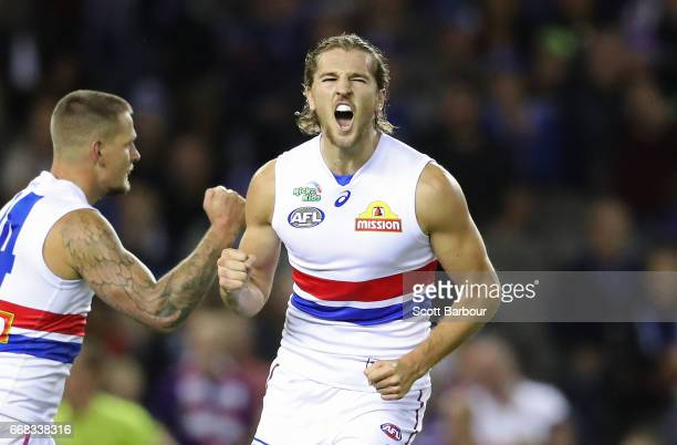 Marcus Bontempelli of the Bulldogs celebrates after kicking a goal during the round four AFL match between the North Melbourne Kangaroos and the...