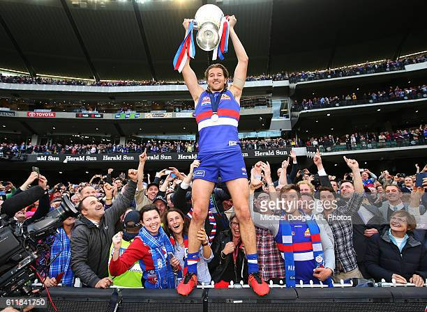Marcus Bontempelli of the Bulldogs celebrates the win with fans during the 2016 AFL Grand Final match between the Sydney Swans and the Western...