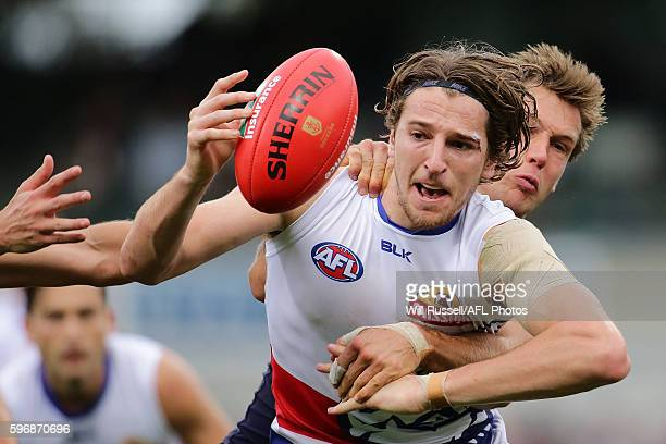Marcus Bontempelli of the Bulldogs controls the ball during the round 23 AFL match between the Fremantle Dockers and the Western Bulldogs at Domain...
